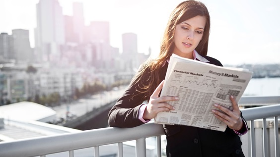 Girl reading newspaper